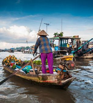Los mercados flotantes, el mayor atractivo del delta de r�o de los Nueve Dragones, como los vietnamitas llaman al Mekong. Foto: Shutterstock.